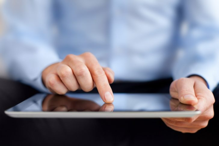Man interacting with a tablet