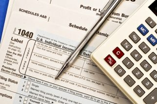 Tax paperwork with pen and calculator