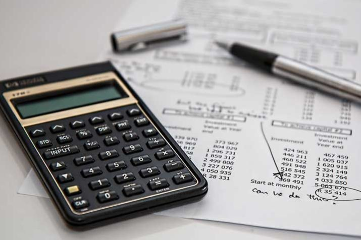 Illustration of a Calculator and a Paper Statement