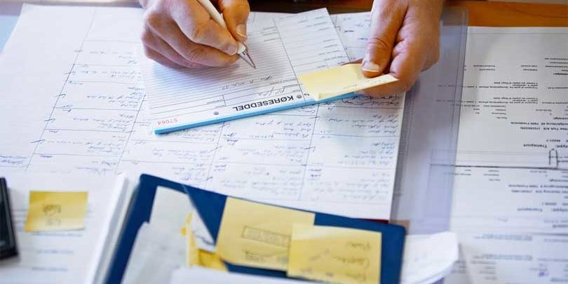 Man filling out financial statements