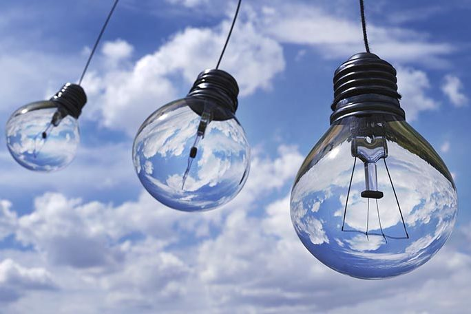 Cloud based bookkeeping - Clouds behind three light bulbs.