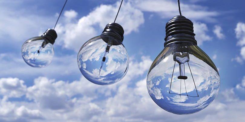 Cloud based bookkeeping - Clouds behind three light bulbs.